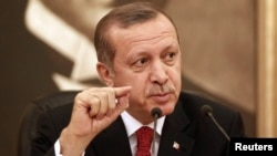 FILE - Turkey's Prime Minister Recep Tayyip Erdogan talks to the media in Istanbul.