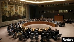 The United Nations Security Council votes to approve a resolution at the U.N. headquarters in New York, July 20, 2015.