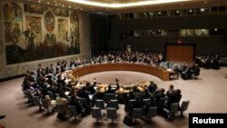 FILE - The United Nations Security Council votes to approve a resolution at U.N. headquarters in New York, July 20, 2015. On Wednesday the body backed renewing sanctions against South Sudan's leaders for another year.