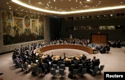 FILE - The United Nations Security Council votes to approve a resolution at the U.N. headquarters in New York.