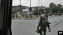 In this image taken on a mobile phone, a Syrian soldier patrols streets in Damascus, Syria, May 8, 2011