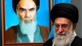 Supreme Leader Ali Khamenei, shown here with a painting of his predecessor, the late Ayatollah Khomenei, is the ultimate power in Iran.