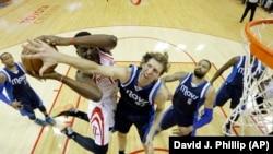 Dallas Maverick player blocks shot from the Houston Rockets, April 2015. (AP Photo/David J. Phillip)