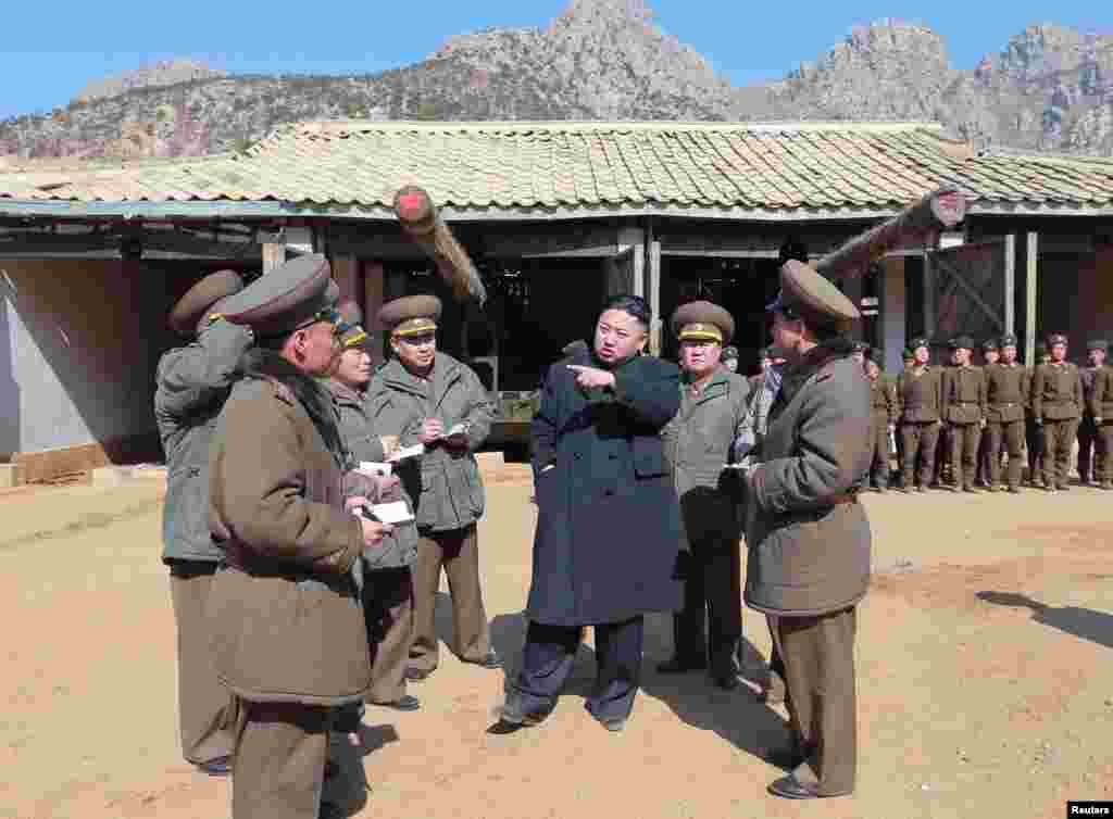 North Korean leader Kim Jong Un visits a long-range artillery sub-unit of the Korean People's Army Unit 641, March 11, 2013. (KCNA)