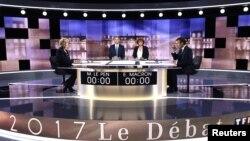 Marine Le Pen et Emmanuel Macron, candidats à la présidence française, sur le plateau de TF1, le 3 mai 2017.