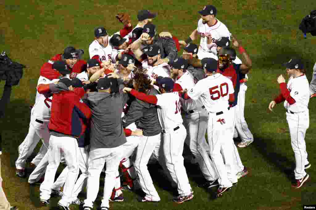 The Boston Red Sox react after defeating the St. Louis Cardinals in game six of the MLB baseball World Series at Fenway Park. Red Sox won 6-1. Mandatory Credit: Mark L. Baer-USA TODAY Sports