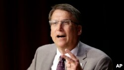 FILE - North Carolina Gov. Pat McCrory comments on House Bill 2 while speaking during a government affairs conference in Raleigh, North Carolina, May 4, 2016.
