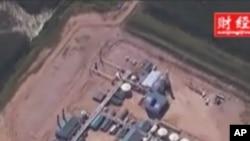 加拿大油砂矿用原位抽取法开采油砂