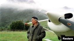 FILE - Millionaire American conservationist Douglas Tompkins stands on his land in this file photo from January 2000 during a interview with the local media.