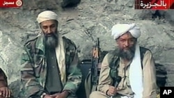 Osama bin Laden (L) and his top lieutenant, Egyptian Ayman al-Zawahri are seen at an undisclosed location in this TV image broadcast, October 2001 (file photo)