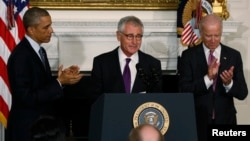 U.S. President Barack Obama, Defense Secretary Chuck Hagel and Vice President Joe Biden at the White House Monday to announce Hagel's resignation (Reuters)