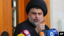 Sh'iite cleric Moqtada al-Sadr speaks during a media conference in Najaf, Iraq, 160 kilometers south of Baghdad, April 30, 2016. Hundreds of Sadr's supporters have been holoding anti-government protests.