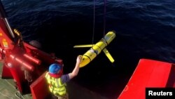 FILE - Crew members aboard the VOS Raasay recover U.S. and British Royal Navy ocean gliders taking part in the Unmanned Warrior exercise off the northwest coast of Scotland on October 8, 2016. A similar unmanned underwater vehicle was seized by the Chines