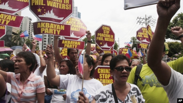 Protesters march towards the Chinese consulate during a rally in Manila's financial district of Makati, Philippines, May 11, 2012.