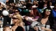 FILE - Women breastfeed babies during a mass event in Athens, Greece, Nov. 2, 2014.