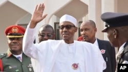 Nigeria President Muhammadu Buhari, waves after a meeting in Abuja, Nigeria, Monday, Jan. 9, 2017. (AP Photo/ Azeez Akunleyan)