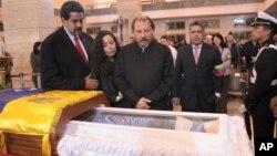 President Daniel Ortega and his wife Rosa Murillo mourn Hugo Chavez.