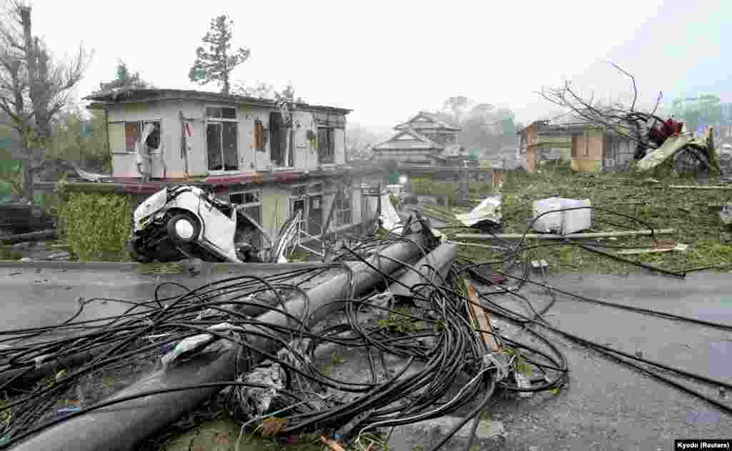 Destroyed houses, cars and power poles, which according to local media were believed to be caused by a tornado, are seen as Typhoon Hagibis approaches the Tokyo area in Ichihara, east of Tokyo, Japan, Oct. 12, 2019.