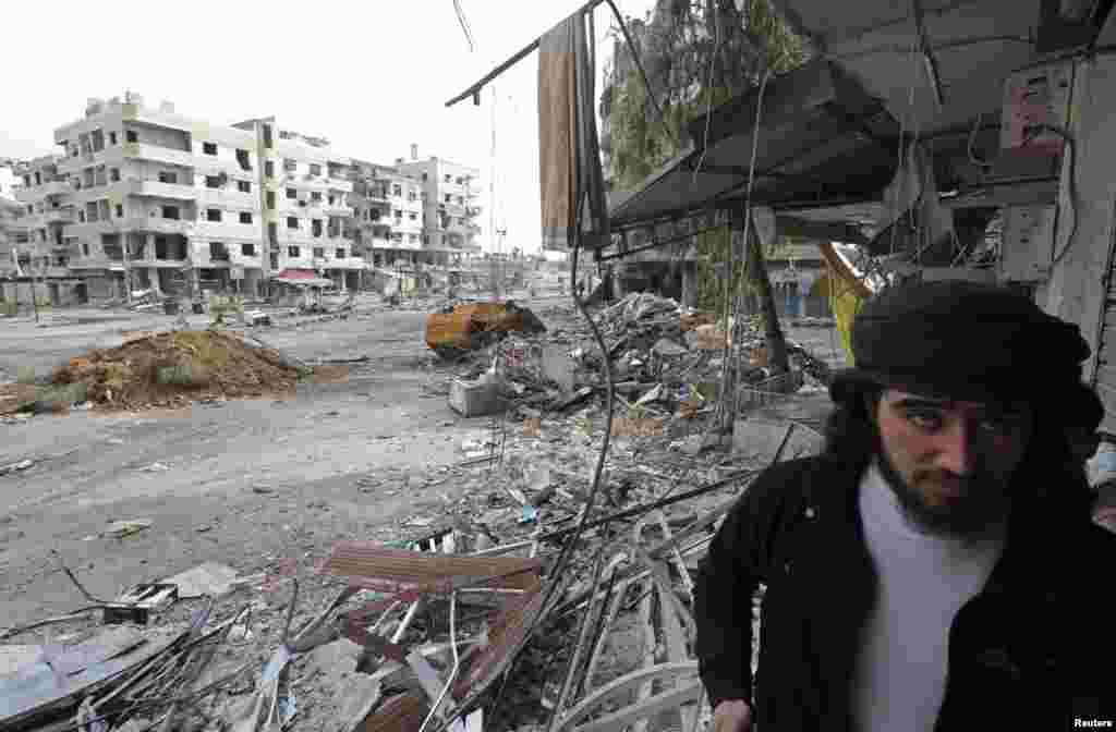 A Free Syrian Army fighter walks in the Haresta neighborhood of Damascus Feb. 7, 2013.