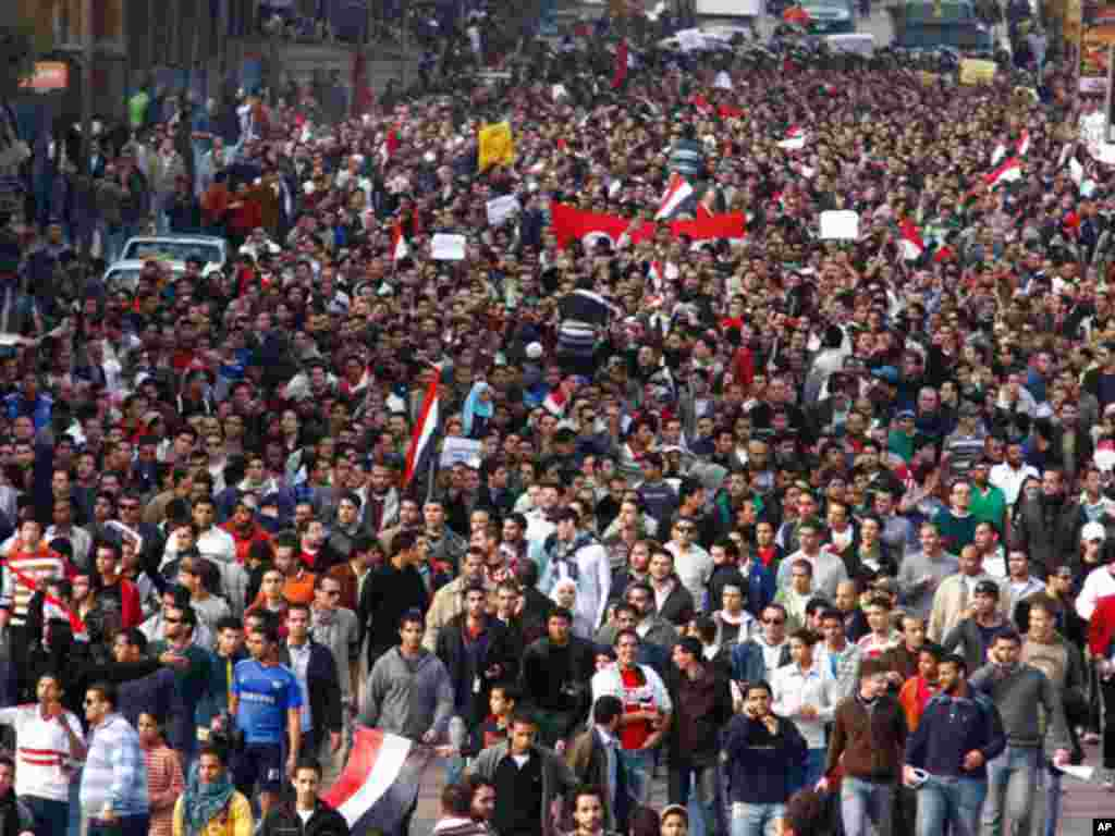 On January 25, 2011, a crowd of demonstrators walk through Cairo in a Tunisia-inspired demonstration to demand the end of Egyptian President Hosni Mubarak's nearly 30 years in power. (AP)