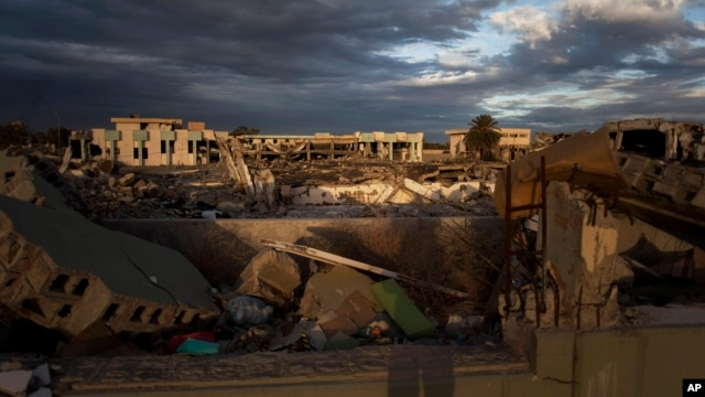Buildings destroyed in the Bab al-Aziziya compound and an occupied intact building in Tripoli, Libya  Nov. 26, 2013(AP Photo/Manu Brabo)
