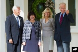 Vice President Joe Biden and Dr. Jill Biden pose for a photograph with Vice President-elect Mike Pence and his wife, Karen, after they had lunch at the Vice President's home at the Naval Observatory in Washington, Nov. 16, 2016.