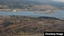 This area of the low-lying peninsula in front of Eureka, California is the proposed location of a tsunami evacuation berm. (Coastal Records Project via Lori Dengler)