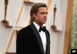 Brad Pitt arrives at the Oscars on Sunday, Feb. 9, 2020, at the Dolby Theatre in Los Angeles. (Photo by Richard Shotwell/Invision/AP)