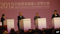 三位香政行政長官候選人梁振英(右起)、何俊仁、唐英年、出席選委舉辦的行政長官候選人答問大會