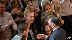 University of Utah students shake hands with former presidential candidate Mitt Romney after he made a speech criticizing Donald Trump Thursday, March 3, 2016, in Salt Lake City. The 2012 GOP presidential nominee has been critical of front-runner Donald Trump on Twitter in recent weeks and has yet to endorse a candidates. (Al Hartmann/The Salt Lake Tribune via AP)