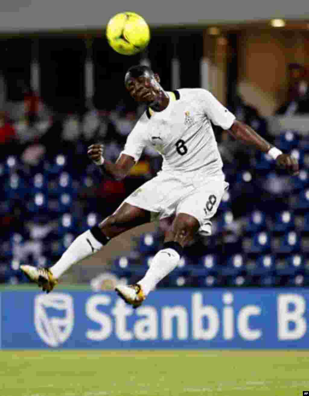 Ghana's Emmaneul Badu Agyemang jumps for the ball during their African Nations Cup quarter-final soccer match against Tunisia at Franceville stadium February 5, 2012.