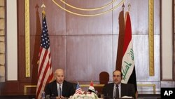U.S. Vice President Joseph Biden, left, and Iraqi Prime Minister Nouri al-Maliki, right, hold a joint news conference in Baghdad, Iraq, Nov. 30, 2011.