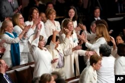 Members of Congress cheer after President Donald Trump acknowledges more women in Congress during his State of the Union address to a joint session of Congress on Capitol Hill in Washington, Tuesday, Feb. 5, 2019. (AP Photo/Carolyn Kaster)