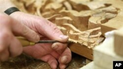 Teens learn to follow directions and make projects in wood-working class.