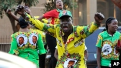 FILE: Supporters of Zimbabwean President Emmerson Mnangagwa celebrate in Harare, Friday, August, 24, 2018.