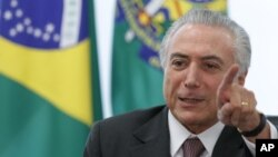 FILE - The administration of Brazilian President Michel Temer has been cautious in reacting to the U.S. election, but officials have acknowledged that the country's incipient recovery could suffer if Donald Trump makes good on his promises to limit trade.