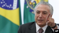 FILE - Brazil President Michel Temer speaks during a meeting with trade unions on the government's proposal for Social Security reform in Brasilia, Brazil, May 16, 2016. Temer sent Donald Trump his congratulations and hopes they can work together.