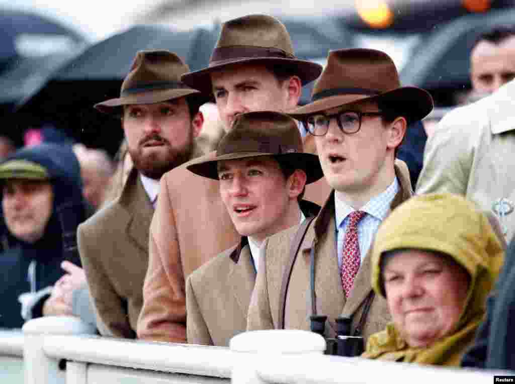 Cheltenham Festival racegoers react to the horse race on the Cheltenham Racecourse, Cheltenham, Britain.