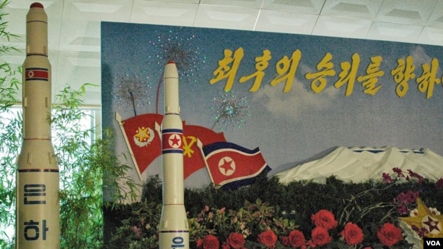 "A model of the ""Unha-9"" missile on display at a floral exhibition in Pyongyang (Credit: Steve Herman / VOA News 26 July, 2013 Pyongyang)"