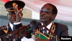 FILE: Zimbabwe's President Robert Mugabe is seen addressing a crowd in Harare August 12, 2013.