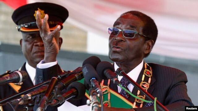 Zimbabwe's President Robert Mugabe is seen addressing a crowd in Harare August 12, 2013.