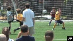 Nine and 10-year-old boys play football in Washington, DCC