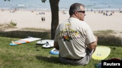 A spectator watches the action at the country's largest freshwater surf event taking place Labor Day weekend in Sheboygan, Wisconsin, September 1, 2012.