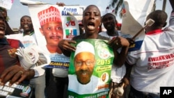 Supporters of former military leader, Muhammadu Buhari, and presidential aspirant, chant slogans during the All Progressive Congress party convention in Lagos, Nigeria,Wednesday, Dec. 10, 2014.