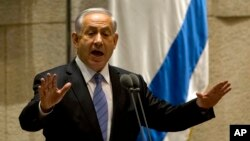 "FILE - The government of Israeli Prime Minister Benjamin Netanyahu, who is shown speaking during a Knesset session in October 2014, said funds would be sent to the Palestinian Authority for humanitarian reasons and ""Israel's interests.''"