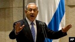 Israeli Prime Minister Benjamin Netanyahu speaks during a session of the Knesset, Israel's parliament, in Jerusalem, Oct. 27, 2014.