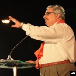 Ibrahim Sharif Al Syed, addresses his supporters in the run-up to parliamentary elections, 21 Oct 2010