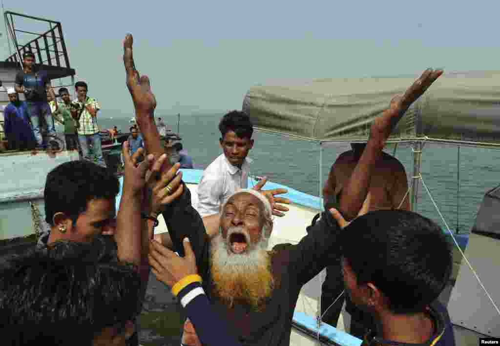 A relative of a missing passenger mourns after a ferry sank on the Meghna river, in Munshiganj, Bangladesh, Feb. 8, 2013.