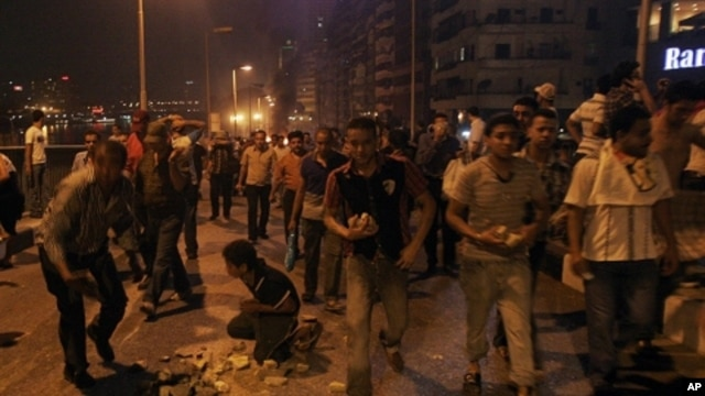 Coptic protesters gather rocks during clashes with Egyptian security forces at a protest of a recent attack on a church in Cairo Egypt, Sunday, Oct. 9, 2011.