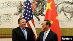 Mike Pompeo shakes hands with Yang Jiechi,